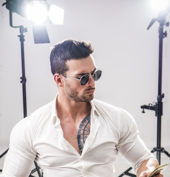 Attractive Vip Man In Studio With Spotlights